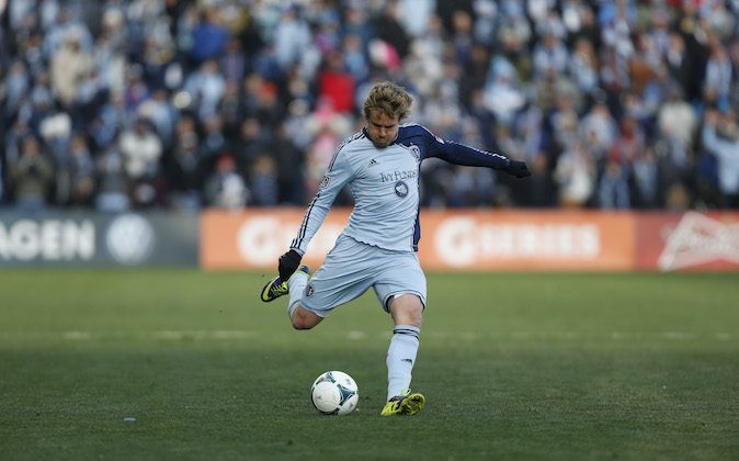 KANSAS CITY, KS - DECEMBER 7:  Chance Myers #7 of Sporting Kansas City kicks the ball during the MLS Cup Final at Sporting Park against the Real Salt Lake on December 7, 2013 in Kansas City, Kansas. (Photo by Ed Zurga/Getty Images)