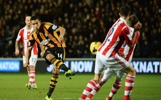 Jake Livermore of Hull City shoots during the Barclays Premier League match between Hull City and Stoke City at KC Stadium on December 14, 2013 in Hull, England. (Photo by Ross Kinnaird/Getty Images)