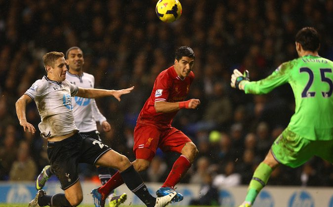 Luis Suarez of Liverpool scores their fourth goal during the Barclays Premier League match between Tottenham Hotspur and Liverpool at White Hart Lane on December 15, 2013 in London, England. (Photo by Paul Gilham/Getty Images)