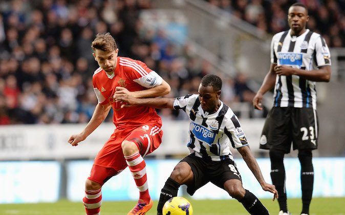 Vurnon Anita of Newcastle United tackles Jay Rodriguez of Southampton during the Barclays Premier League match between Newcastle United and Southampton at St James' Park on December 14, 2013 in Newcastle upon Tyne, England. (Photo by Tony Marshall/Getty Images)