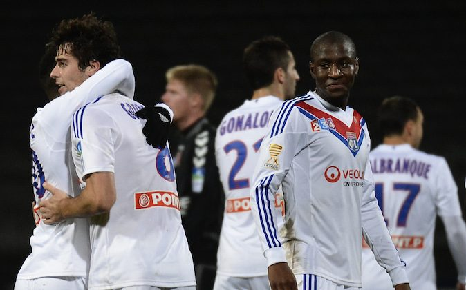 Lyon's French midfielder Yoann Gourcuff (2nd L) celebrates with his teammates after scoring a goal during the French League Cup football match Olympique Lyonnais (OL) vs FC Reims (FCR) on December 18, 2013, at the Gerland Stadium in Lyon, central-eastern France. (JEFF PACHOUD/AFP/Getty Images)