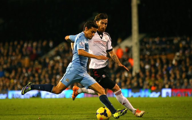 Jesus Navas of Manchester City scores the third goal during the Barclays Premier League match between Fulham and Manchester City at Craven Cottage on December 21, 2013 in London, England. (Photo by Clive Rose/Getty Images)