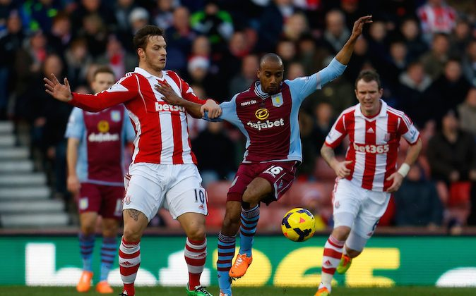 Marko Arnautovic of Stoke in action with Fabian Delph (C) of Aston Villa during the Barclays Premier League match between Stoke City and Aston Villa at the Britannia Stadium on December 21, 2013 in Stoke-on-Trent, England. (Photo by Paul Thomas/Getty Images)