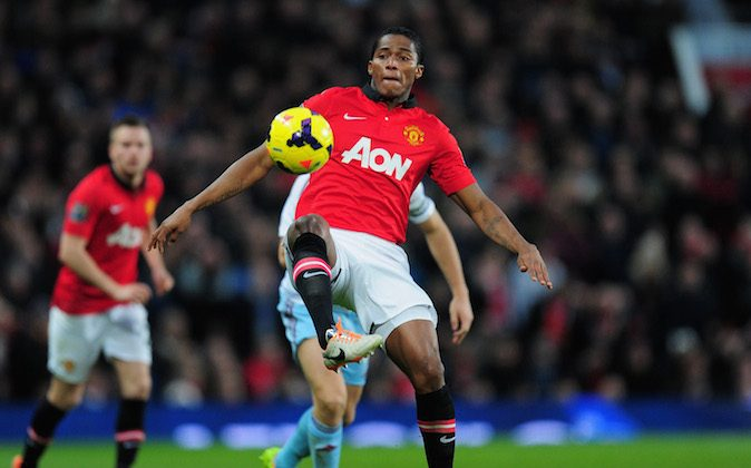 Antonio Valencia of Manchester United in action during the Barclays Premier League match between Manchester United and West Ham United at Old Trafford on December 21, 2013 in Manchester, England. (Photo by Stu Forster/Getty Images)