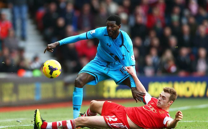 Nacer Chadli of Spurs holds off the challenge from Calum Chambers of Southampton during the Barclays Premier League match between Southampton and Tottenham Hotspur at St Mary's Stadium on December 22, 2013 in Southampton, England. (Photo by Paul Gilham/Getty Images)