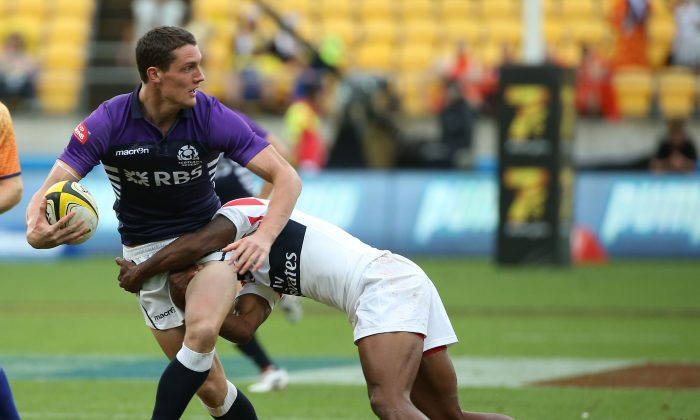 Scotland's Gregor Young is tackled by USA's Folau Niua (R) during the IRB Sevens World Series Pool C match between Scotland and USA at Westpac Stadium on February 7, 2014 in Wellington, New Zealand. (Fiona Goodall/Getty Images)