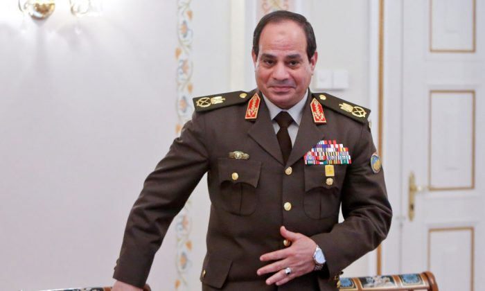 Egyptian army chief Abdel Fattah al-Sisi attends a meeting with Russian President Vladimir Putin in Novo-Ogaryovo, outside Moscow, on February 13, 2014. Abdel Fattah al-Sisi, who is likely Egypt's new president, arrived in Moscow to negotiate a $2-billion arms deal with Russia meant to replace subsiding assistance from old ally Washington. (Maxim Shemetov/AFP/Getty Images)