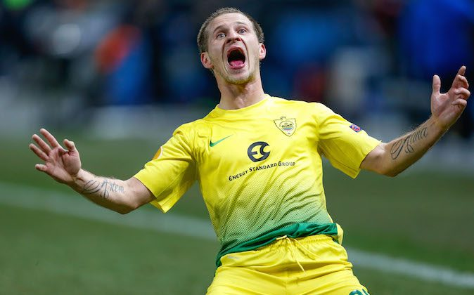 Anzhi Makhachkala's forward Olexandr Aliyev celebrates after scoring during the round of 32 Europa League UEFA football match between KRC Genk and Anzhi Makhachkala at the Fenix Stadium in Genk on February 27, 2014. (BRUNO FAHY/AFP/Getty Images)