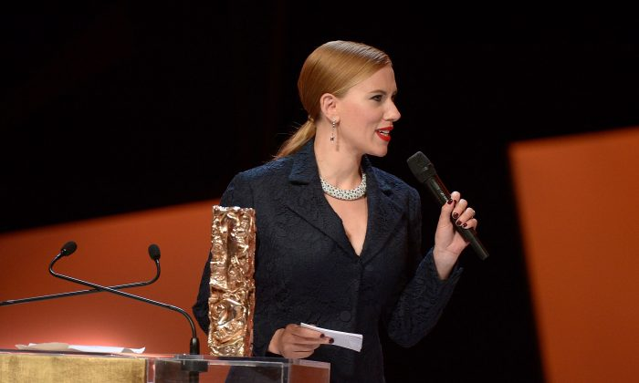 Actress Scarlett Johansson receives the Honorary Cesar on stage during the 39th Cesar Film Awards 2014 at Theatre du Chatelet on February 28, 2014 in Paris, France. (Dominique Charriau/Getty Images)