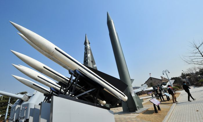 Replicas of a North Korean Scud-B missile (R) and South Korean Hawk surface-to-air missiles (L) at the Korean War Memorial in Seoul on March 3, 2014. North Korea has been firing short-range missiles off its eastern coast since late February, and one launched on Tuesday could have hit a Chinese passenger plane that flew through its trajectory seven minutes later. (Jung Yeon-Je/AFP/Getty Images)