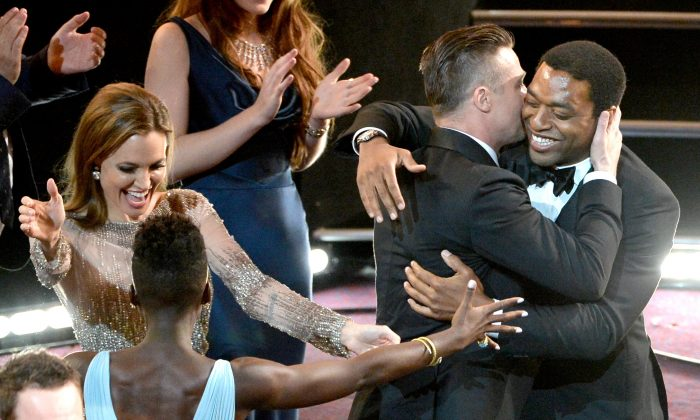 Michael Fassbender, Angelina Jolie, Lupita Nyong'o, producer Brad Pitt and actor Chiwetel Ejiofor celebrate as '12 Years A Slave' is awarded Best Picture during the Oscars at the Dolby Theatre on March 2, 2014 in Hollywood, California. (Kevin Winter/Getty Images)