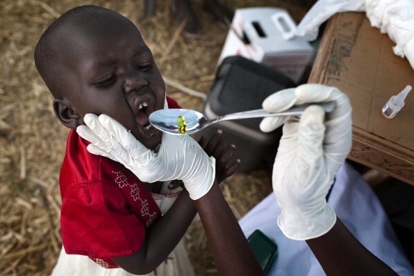 A South Sudanese child receives a dose of vitamin A. (JM LOPEZ/AFP/Getty Images)