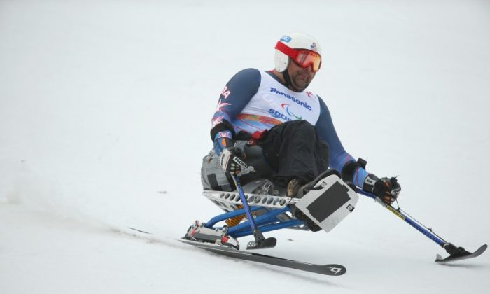 Joe Tompkins of the USA finishes after his run during an official men's sitting skiing training session at Rosa Khutor Alpine Center ahead of the 2014 Winter Paralympics on March 5, 2014 in Sochi, Russia. (Mark Kolbe/Getty Images)