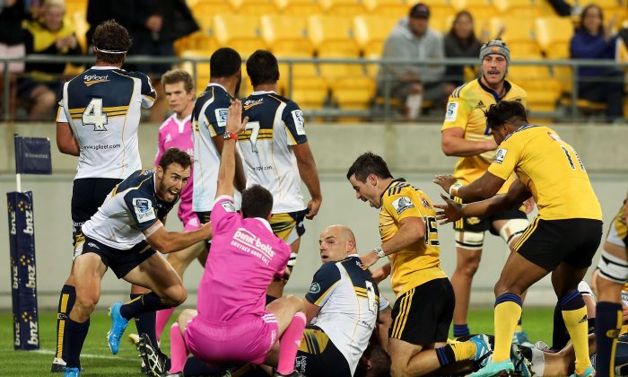 Andrew Smith of the Brumbies appeals to referee Craig Joubert as he awards a try to TJ Perenara of the Hurricanes during the round four Super Rugby match between the Hurricanes and the Brumbies at Westpac Stadium on March 7, 2014 in Wellington, New Zealand. (Hagen Hopkins/Getty Images)