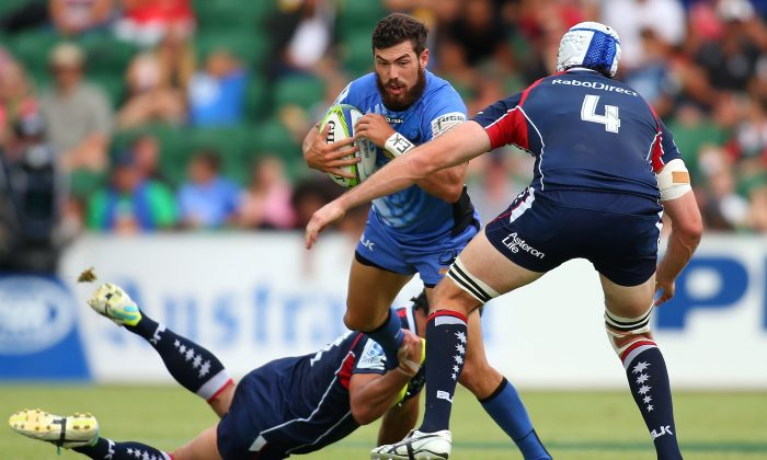 Jayden Hayward of the Force gets tackled during the round four Super Rugby match between the Western Force and the Melbourne Rebels at nib Stadium on March 8, 2014 in Perth, Australia. (Paul Kane/Getty Images)