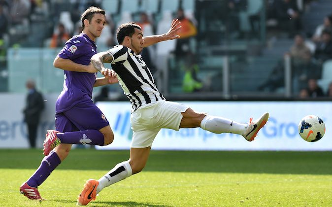 Carlos Tevez (R) of Juventus in action agaist Gonzalo Rodriguez of ACF Fiorentina during the Serie A match between Juventus and ACF Fiorentina at Juventus Arena on March 9, 2014 in Turin, Italy. (Photo by Valerio Pennicino/Getty Images)