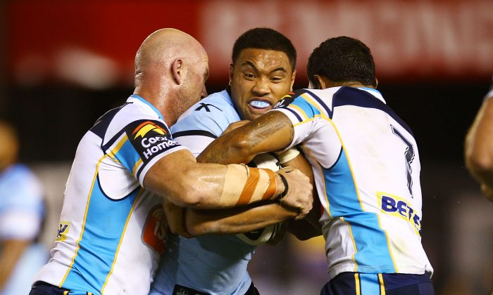 Tupou Sopoaga of the Sharks is tackled during the round one NRL match between the Cronulla Sharks and the Gold Coast Titans at Remondis Stadium on March 10, 2014 in Sydney, Australia. (Mark Nolan/Getty Images)