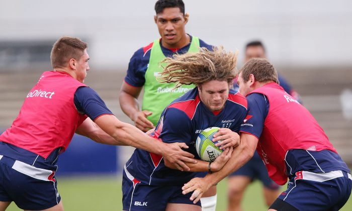 Jordy Reid gets tackled during a Melbourne Rebels Super Rugby training session at Visy Park on March 11, 2014 in Melbourne, Australia. (Michael Dodge/Getty Images)