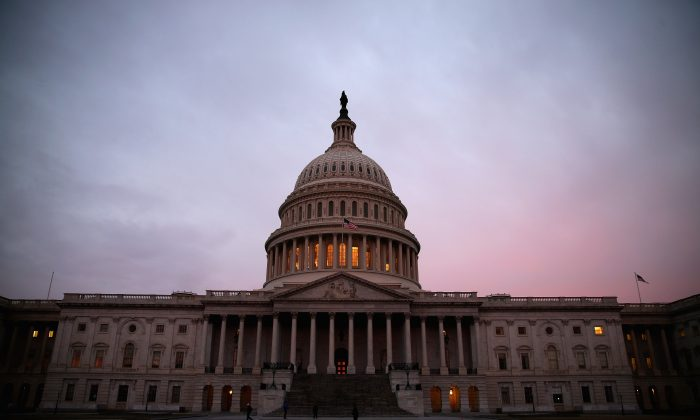 The American Flag flies over the Senate side of the U.S. Capitol. The government and the private sector are plotting to nudge you into acting in your best interest. (Mark Wilson/Getty Images)