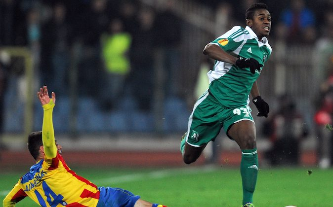 Ludogorets's forward Virgil Misidjan fights for the ball with Valencia's midfielder Juan Bernat during their round 16 qualifying UEFA Europa League match at the Vassil Levski stadium in Sofia on March 13, 2014. (NIKOLAY DOYCHINOV/AFP/Getty Images)
