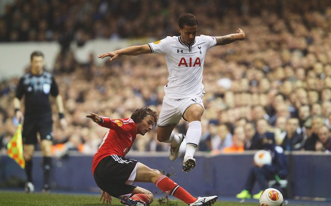 Kyle Naughton of Tottenham Hotspur is tackled by Lazar Markovic of Benfica during the UEFA Europa League Round of 16 first leg match between Tottenham Hotspur FC and SL Benfica at White Hart Lane on March 13, 2014 in London, England. (Photo by Clive Rose/Getty Images)