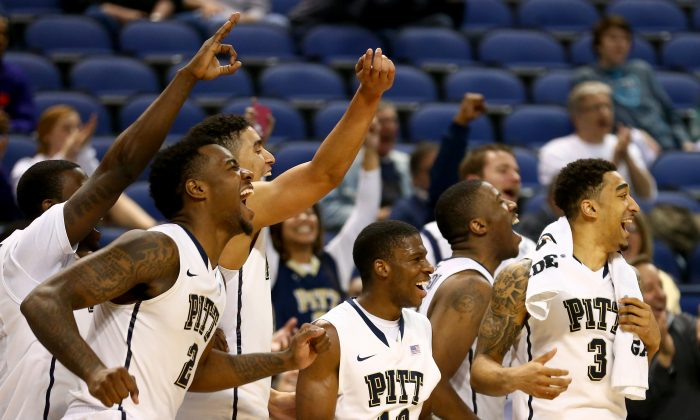 The Pittsburgh Panthers celebrate after defeating the Wake Forest Demon Deacons 84-55 during the second round of the 2014 Men's ACC Basketball Tournament at Greensboro Coliseum on March 13, 2014 in Greensboro, North Carolina. (Streeter Lecka/Getty Images)
