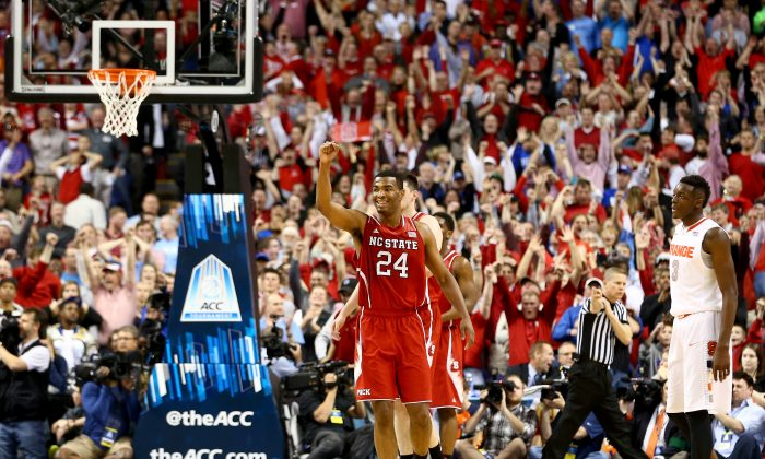 T.J. Warren #24 of the North Carolina State Wolfpack celebrates after defeating the Syracuse Orange 66-63 during the quarterfinals of the 2014 Men's ACC Basketball Tournament at Greensboro Coliseum on March 14, 2014. (Streeter Lecka/Getty Images)
