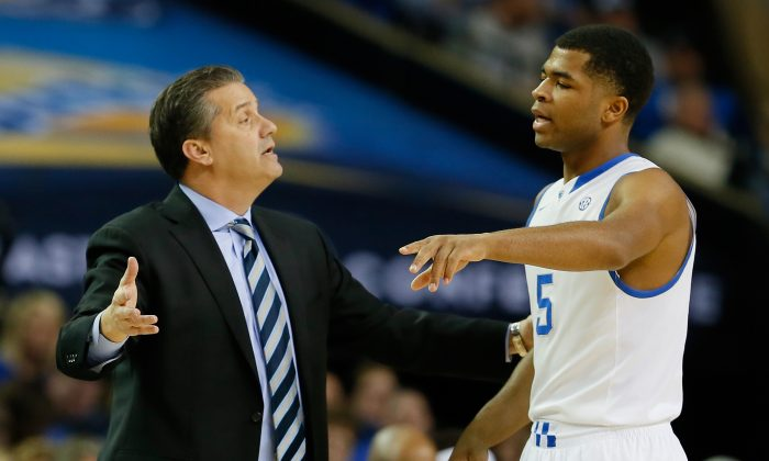 Head coach John Calipari of the Kentucky Wildcats converses with Andrew Harrison #5 against the LSU Tigers during the quarterfinals of the SEC Men's Basketball Tournament at Georgia Dome on March 14, 2014 in Atlanta. (Kevin C. Cox/Getty Images)