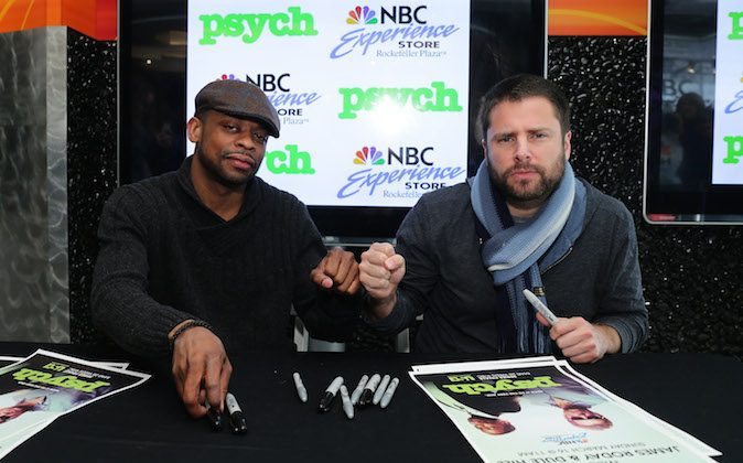 Actors Dule Hill (L) and James Roday attend the USA's 'Psych' meet and greet at the NBC Experience Store on March 16, 2014 in New York City. (Photo by Neilson Barnard/Getty Images)