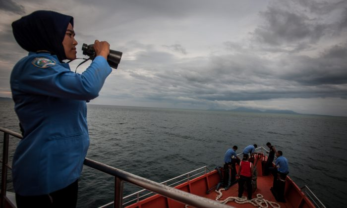A personnel of Indonesia's National Search and Rescue looks over horizon during a search in the Andaman sea area around northern tip of Indonesia's Sumatra island for the missing Malaysian Airlines flight MH370 on March 17, 2014. (AFP/Getty Images)