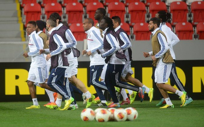 Lyon's playerss warm up during a training session on the eve of the last 16 second-leg UEFA Europa League football match FC Viktoria Plzen vs Olympique Lyonnais on March 19, 2014 in Plzen, Czech Republic. (MICHAL CIZEK/AFP/Getty Images)