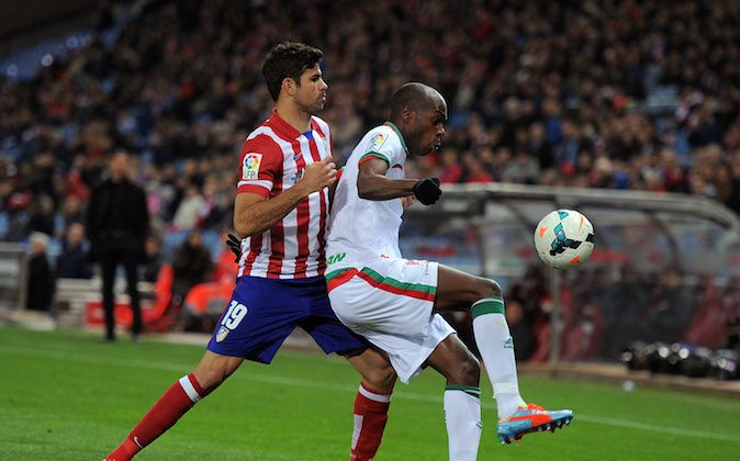 Diego Costa (L) of Club Atletico de Madrid tackles Allan Nyom of Granada CF during the La Liga match between Club Atletico de Madrid and Granada CF at Vicente Calderon Stadium on March 26, 2014 in Madrid, Spain. (Photo by Denis Doyle/Getty Images)