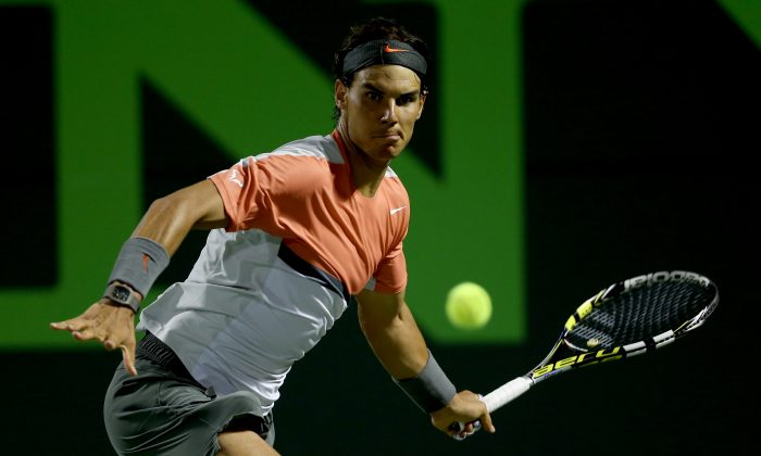 Rafael Nadal of Spain returns a shot to Milos Roanic of Canada during the Sony Open at the Crandon Park Tennis Center on March 27, 2014 in Key Biscayne, Florida. (Matthew Stockman/Getty Images)