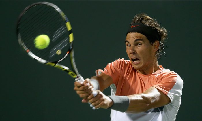 Rafael Nadal of Spain plays a backhand against Milos Raonic of Canada during their quarter final round match during day 11 at the Sony Open at Crandon Park Tennis Cente on March 27, 2014 in Key Biscayne, Florida. (Clive Brunskill/Getty Images)
