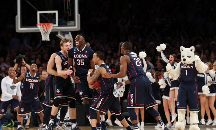 The Connecticut Huskies celebrate after defeating the Michigan State Spartans during the East Regional Final of the 2014 NCAA Men's Basketball Tournament at Madison Square Garden on March 30, 2014 in New York City. (Bruce Bennett/Getty Images)