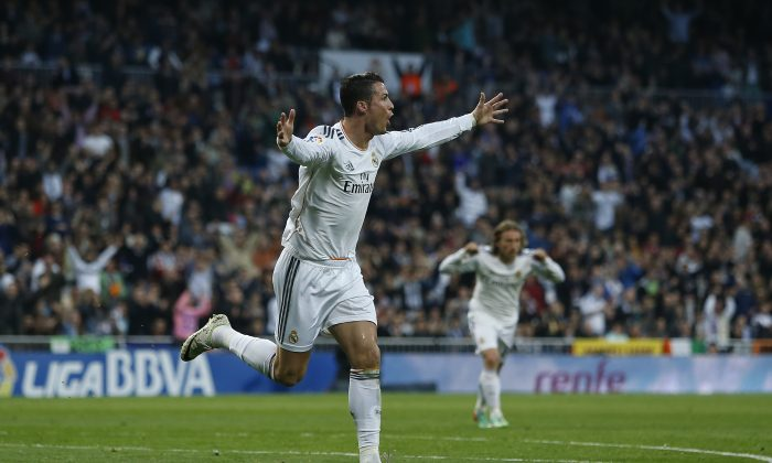 Real's Cristiano Ronaldo celebrates his goal during a Spanish La Liga soccer match between Real Madrid and Levante at the Santiago Bernabeu stadium in Madrid, Spain, Sunday, March 9, 2014. (AP Photo/Andres Kudacki)