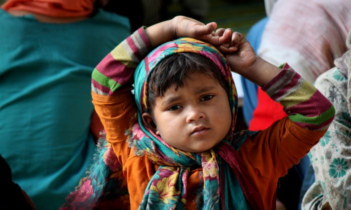 A girl of Rohingya Muslim refugees in the premises of the tomb of Rakhbour Pir Baba, a local Muslim saint, in the Narwal area of Jammu, India, on Feb. 9, 2014. According to the UN refugee agency there are 3700 Rohingya refugees and asylum seekers in Jammu, a northern Indian city. (Venus Upadhayaya/Epoch Times)
