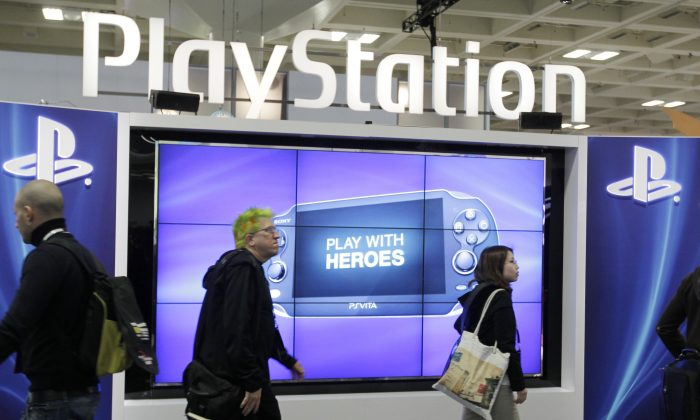 "Lizard Squad and Finest Squad have apparently been doing battle over PlayStation Network and Xbox Live.  This March 8, 2012 file photo shows attendees walking past the Sony PlayStation PS Vita console on display in the Sony PlayStation booth at the Game Developers Conference in San Francisco. Despite a refreshed focus on real-world issues at the 2014 GDC convention that kicks-off Monday, March 17, 2014, the ever-changing virtual world and how to view and interact with it will take center stage at GDC. PlayStation 4 creator Sony Corp. is expected to tease its rendition of virtual reality technology during a Tuesday presentation called ""Driving the Future of Innovation at Sony Computer Entertainment."" (AP Photo/Paul Sakuma, file)"