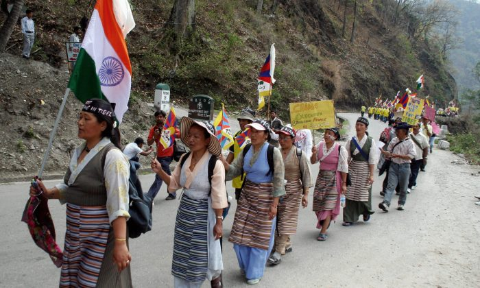Tibetan Buddhist monks in exile and demonstrators march towards the West Bengal-Sikkim interstate border in Rangpo on March 24, 2008 as they continued their march towards the Indo-Chinese border at Nathu-La. (Diptendu Dutta/AFP/Getty Images)