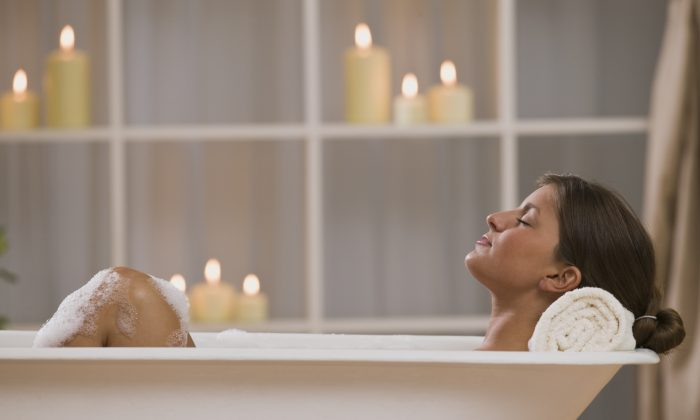 Put a few drops of essential oil into a hot bath for the combined effects of aromatherapy and hydrotherapy. (Comstock Images/photos.com)
