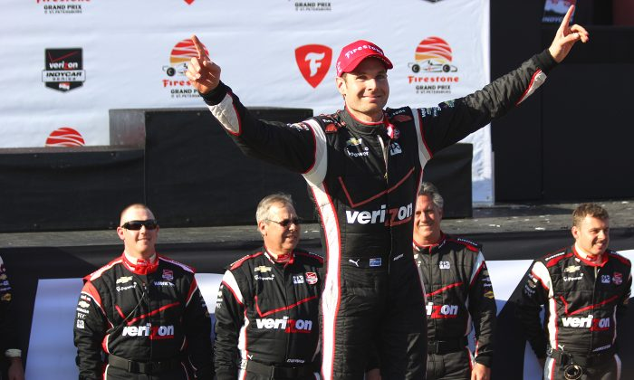 Will Power stands atop the #12 Verizon Penske Dallara Chevrolet which carried him to victory in the 2014 IndyCar Firestone Grand Prix of St. Petersburg while his crew stands behind him, St. Petersburg, Florida on March 30, 2014. (Chris Jasurek/Epoch Times)