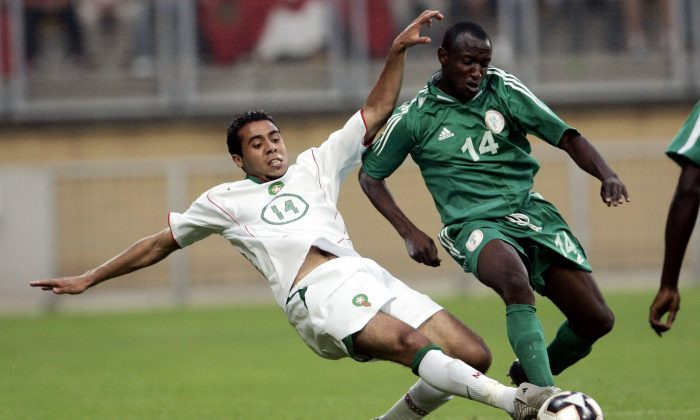 Morocco's Rachid Tiberkanine, left,  challenges Nigeria's  David Abwo in a file photo. (AP Photo/Yves Logghe)