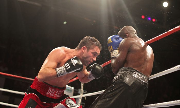 Canadian Antonin Decarie, left, hits France's Souleymane Mbaye during their WBA welterweight world championship match at the Marcel Cerdan hall in Levallois, near Paris, Friday May 28, 2010. Mbaye defeated Decarie. (AP Photo/Thibault Camus)