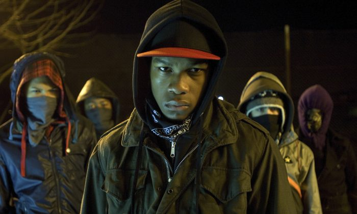 """John Boyega in a scene from """"Attack the Block."""" He could be cast as the new lead in the Star Wars universe. (AP Photo/Sony Screen Gems, Liam Daniel)"""