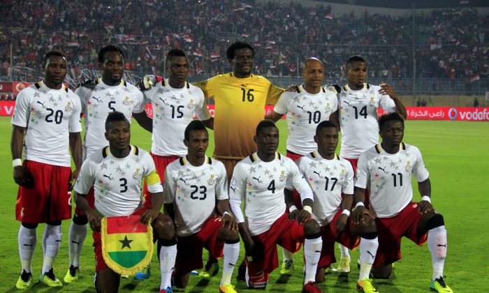 Ghana's national soccer team poses for a group photo at their World Cup qualifying playoff second leg soccer match against Egypt, at the Air Defense Stadium in Cairo, Egypt, Tuesday, Nov. 19, 2013. Top row from left: Kwadwo Asamoah, Michael Essien, Rashid Sumaila, Fatau Dauda, André Ayew, Jerry Akaminko. Bottom row from left: Asamoah Gyan, Harrison Afful, Daniel Opare, Majeed Waris, Sulley Muntari. (AP Photo/Ahmed Gomaa)