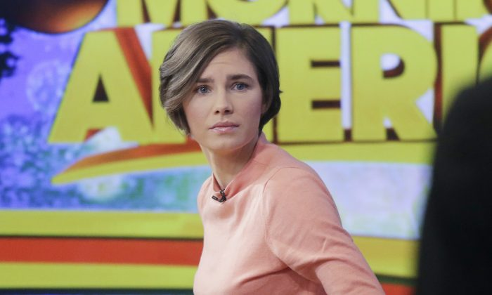Amanda Knox prepares to leave the set following a television interview in N.Y., on Jan. 31, 2014. (Mark Lennihan/Photo via AP)