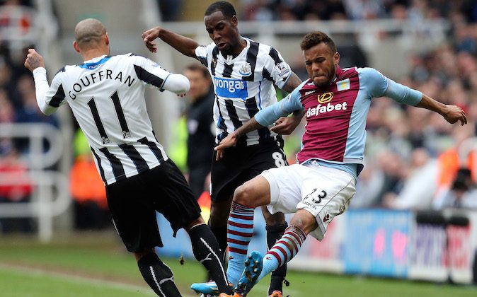 Aston Villa's Ryan Bertrand, right, vies for the ball with Newcastle United's Yoan Gouffran, left, and Vurnon Anita, center, during their English Premier League soccer match at St James' Park, Newcastle, England, Sunday, Feb. 23, 2014. (AP Photo/Scott Heppell)