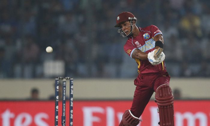 West Indies' batsman Lendl Simmons plays a shot during their ICC Twenty20 Cricket World Cup match against India in Dhaka, Bangladesh, Sunday, March 23, 2014. (AP Photo/Aijaz Rahi)