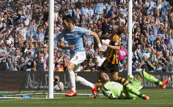 Manchester City's Alvaro Negredo, centre, wheels away to celebrate after scoring past Hull's goalkeeper Allan McGregor, bottom right, during their English Premier League soccer match at The Etihad Stadium, Manchester, England, Saturday Aug. 31, 2013. (AP Photo/Jon Super)