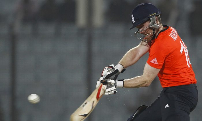 England's Eoin Morgan plays a shot during the ICC Twenty20 Cricket World Cup match against Sri Lanka in Chittagong, Bangladesh, Thursday, March 27, 2014. (AP Photo/A.M. Ahad)